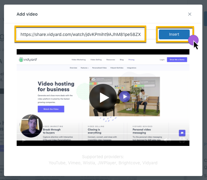 Pasting the sharing page URL of your video into the field to embed a video on your article